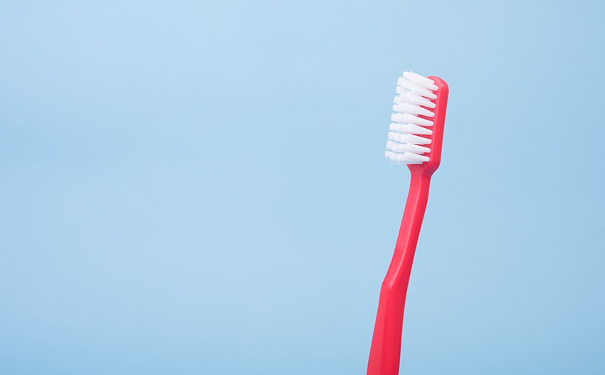 Toothbrush to clean glass shower screen